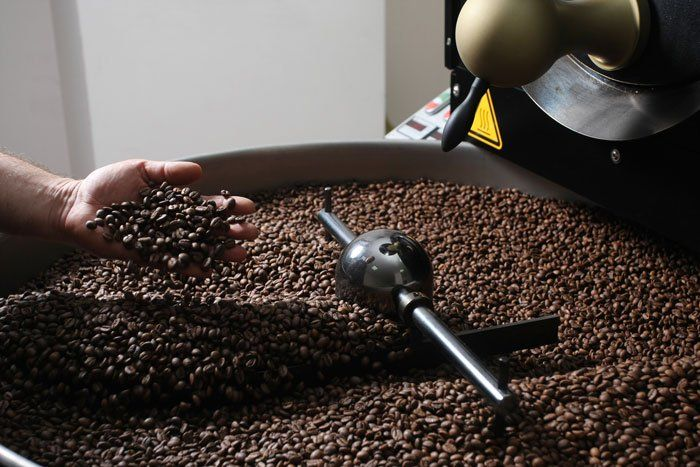 Roasting coffee beans in the middle of the store