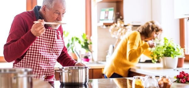 senior-couple-preparing-food-in-the-kitchen-PS9TBE9.jpg