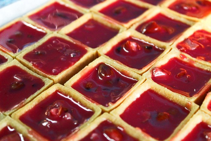 Pink Praline melted in mini square tarts